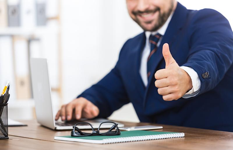 Sign of success. Businessman showing thumb up, working on laptop in office, crop, copy space