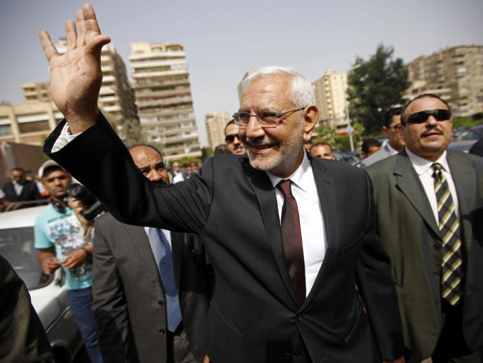 FILE - In this May 23, 2012 file photo, Egyptian presidential candidate Abdel-Monaem Abul Fetouh visits a polling station in Nasr City, Cairo, Egypt. An Egyptian court placed nearly 30 people, including politician Abul Fetouh and pro-democracy Alaa Abdel-Fattah, on a terrorism watch list over accusations they joined the banned Muslim Brotherhood, the official gazette reported Monday, Nov. 23, 2020. (AP Photo/Fredrik Persson, File)