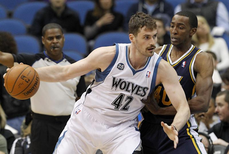 In this Wednesday, April 16, 2014, file photo, Minnesota Timberwolves forward Kevin Love (42) drives against Utah Jazz forward Jeremy Evans during the first quarter of an NBA basketball game in Minneapolis. Three-time NBA All-Star Love could hear his name called on draft night _ again. The Minnesota Timberwolves big man headlines a list of veteran NBA players who could have a major influence on how the draft unfolds, on Thursday, June 26, 2014