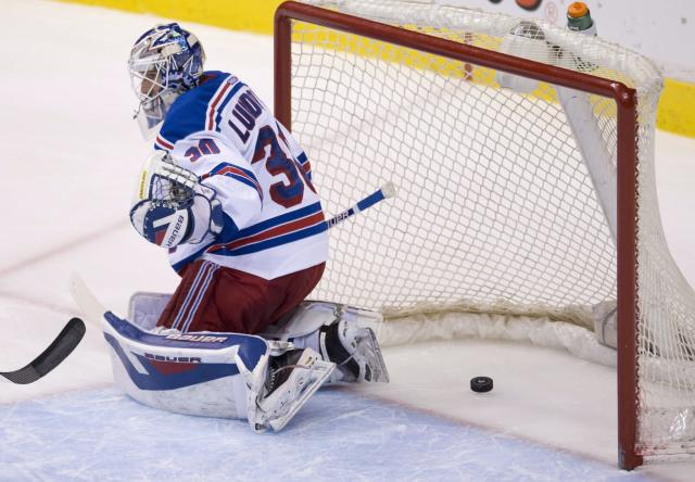 Vancouver Canucks center Ryan Kesler's shot goes past New York Rangers goalie Henrik Lundqvist (30) during the second period of NHL action in Vancouver, British Columbia, Tuesday, April 1, 2014. (AP Photo/The Canadian Press, Jonathan Hayward)