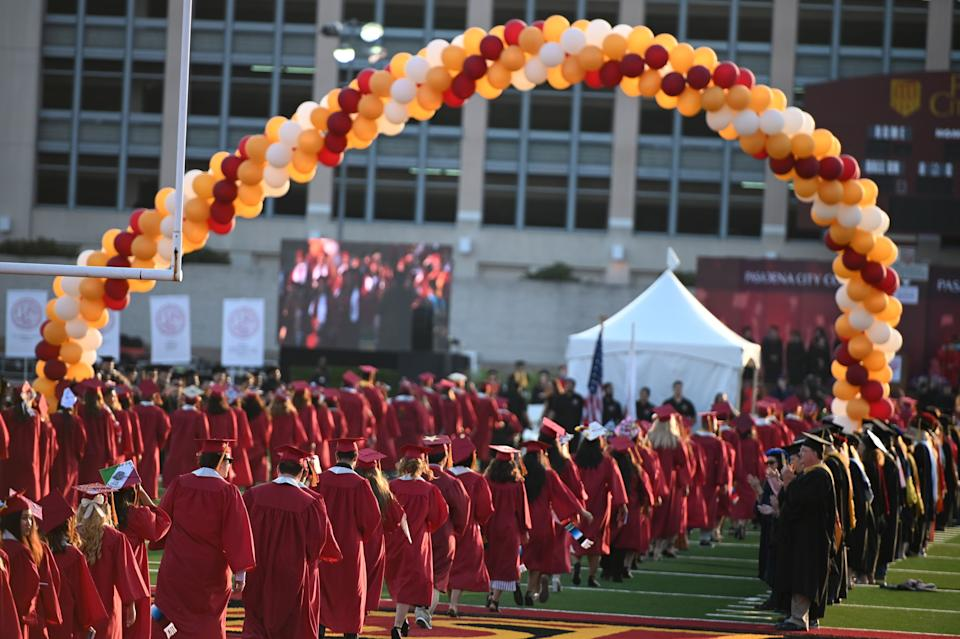 Students earning degrees at Pasadena City College participate in the graduation ceremony on June 14, 2019, in Pasadena, California. (Photo by Robyn Beck / AFP)