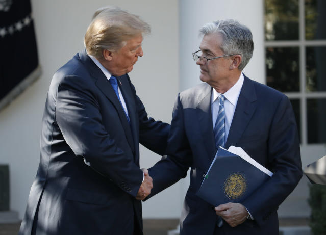 <p>FILE – In this Nov. 2, 2017, file photo, President Donald Trump shakes hands with Federal Reserve board member Jerome Powell after announcing him as his nominee for the next chair of the Federal Reserve, in the Rose Garden of the White House in Washington. Trump has bashed George W. Bush, and the Bush family hasn't shied from hitting back. Despite that ill will, the White House has found it advisable to draw on dozens of veterans from the last Republican administration for their expertise in running the government. (AP Photo/Alex Brandon, File) </p>