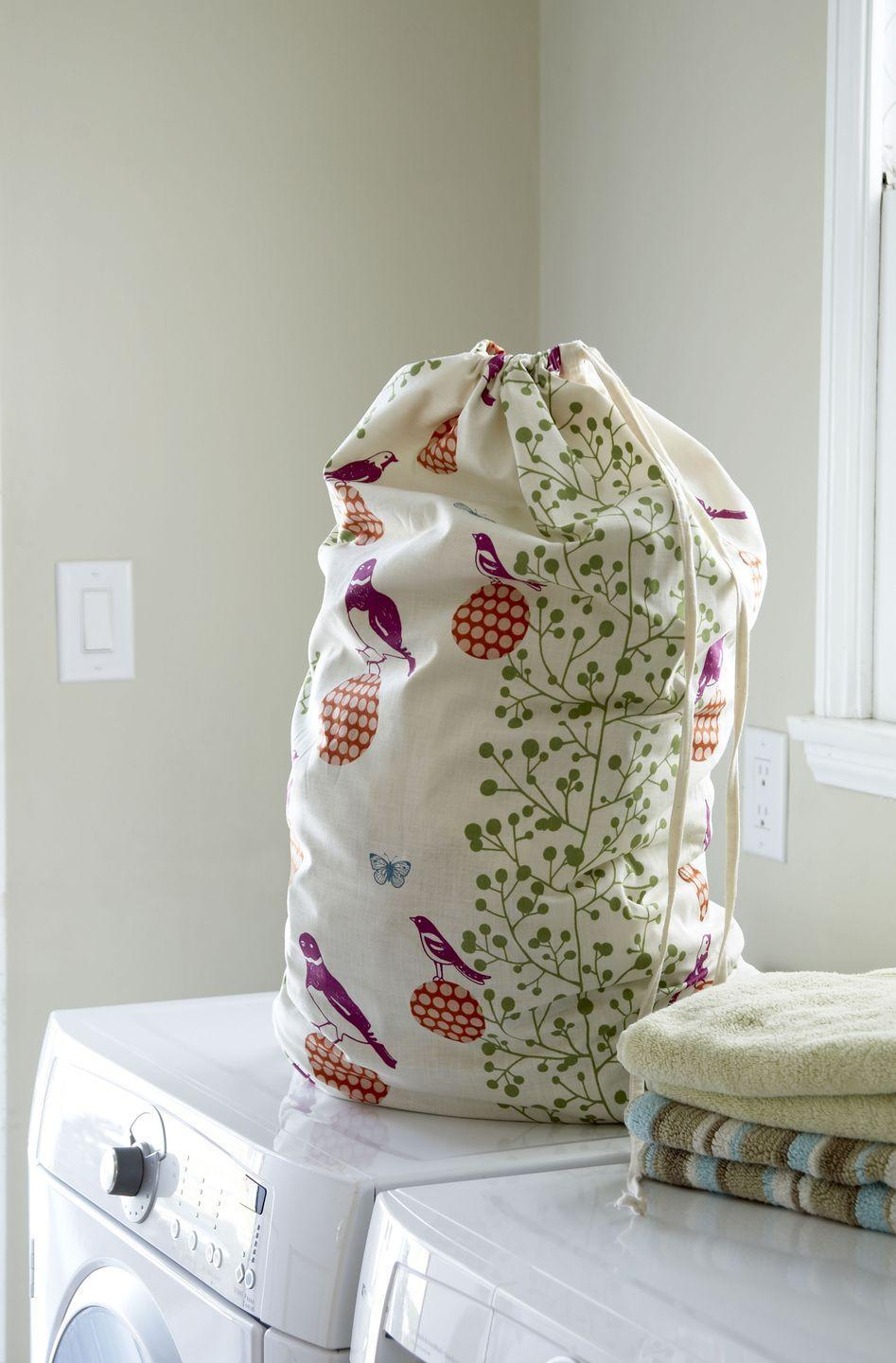 "<p>Instead of a laundry bin in the bathroom, invest in a set of drawstring cotton laundry bags (buy from <a href=""https://www.amazon.co.uk/s?k=drawstring+cotton+laundry+bag&ref=nb_sb_noss&tag=hearstuk-yahoo-21&ascsubtag=%5Bartid%7C2060.g.185%5Bsrc%7Cyahoo-uk"" rel=""nofollow noopener"" target=""_blank"" data-ylk=""slk:Amazon"" class=""link rapid-noclick-resp"">Amazon</a>) to hang on the back of every bedroom door. This avoids dirty clothes piling up on the floor and is also more hygienic, as the bags can be washed too.</p><p><strong>More: </strong><a href=""http://www.housebeautiful.co.uk/lifestyle/cleaning/news/a93/how-to-clean-a-washing-machine/"" rel=""nofollow noopener"" target=""_blank"" data-ylk=""slk:How to clean a washing machine"" class=""link rapid-noclick-resp""><strong>How to clean a washing machine</strong></a></p>"