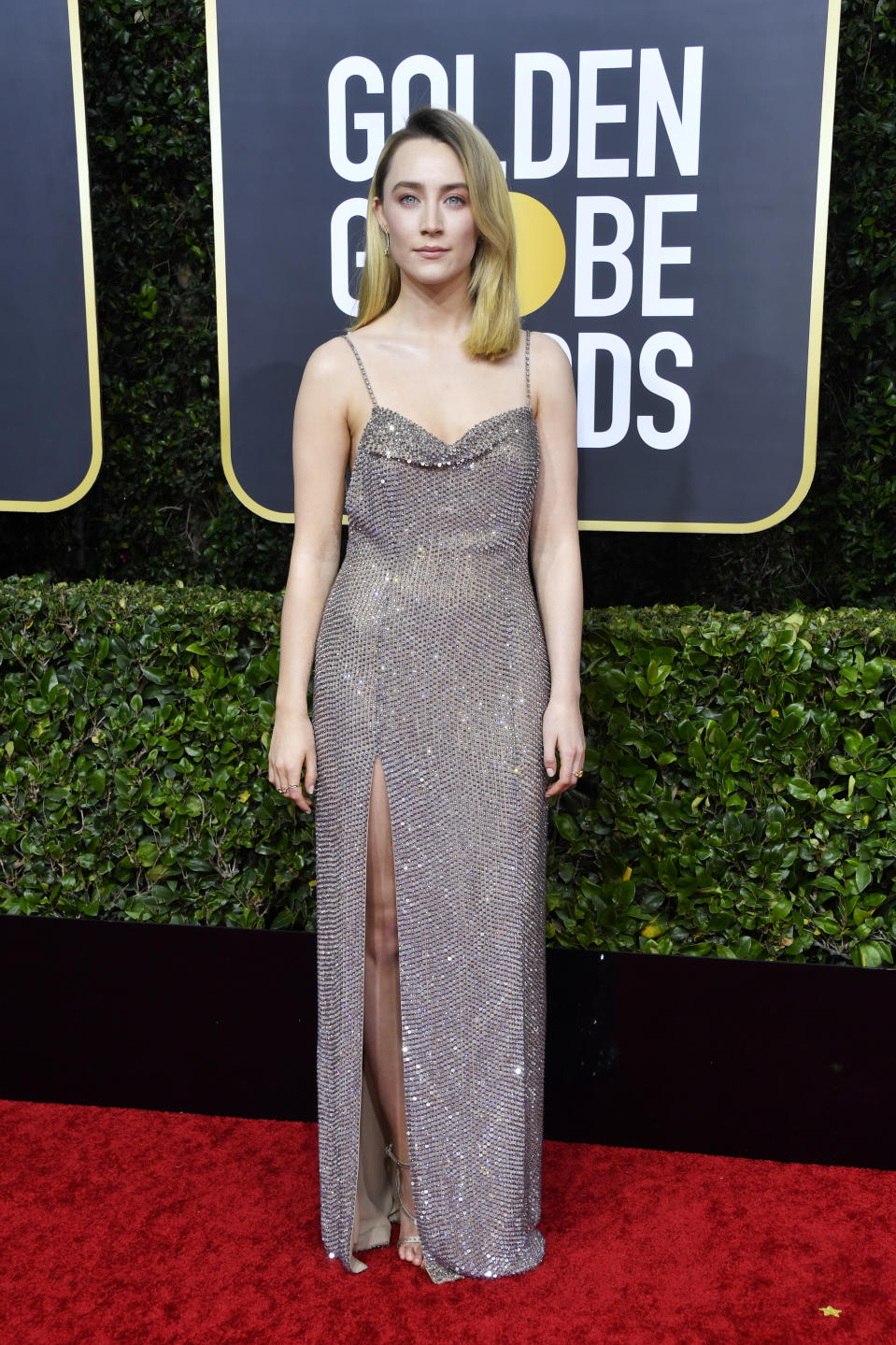 "The ""Little Women"" star shimmered in a silver gown with a thigh-high slit. (Photo by Frazer Harrison/Getty Images)"