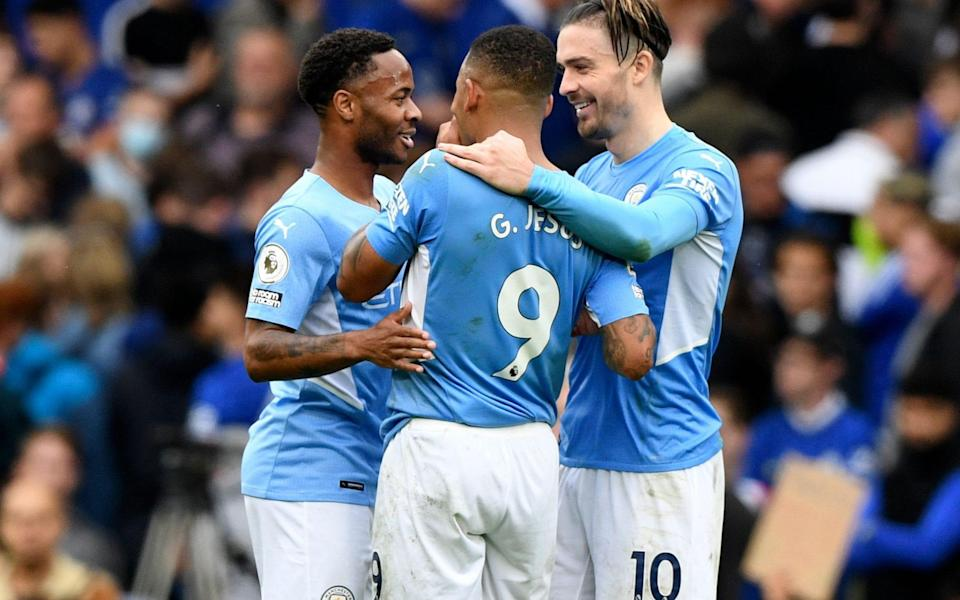 Manchester City players (L-R) Raheem Sterling, Gabriel Jesus, and Jack Grealish celebrate after winning the English Premier League - Shutterstock
