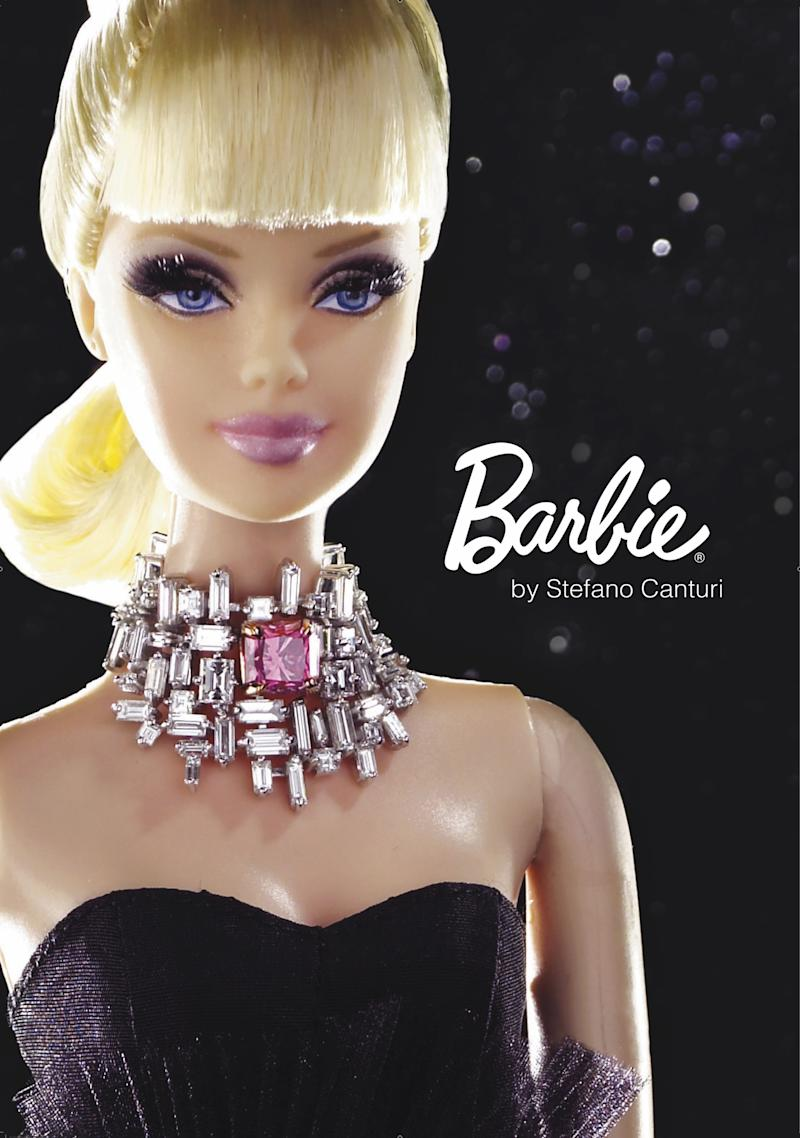 """FILE - This undated photo provided by Canturi Jewels shows a custom-designed Barbie wearing a necklace featuring a one-carat pink diamond, which will make the doll the world's most expensive Barbie when it goes on the auction block.  Barbie has been an astronaut, an architect, a Nascar driver, and a news anchor. Now, there's an online movement to get her to attempt what could be her biggest feat yet: going bald to fight cancer. A Facebook page titled """"Beautiful and Bald Barbie! Let's see if we can get it made"""" was started a few days before Christmas. By Wednesday afternoon, the page had more than 15,000 fans. The goal is to get toy maker Mattel Inc. to create a bald Barbie in support of children with cancer. Friends Rebecca Sypin and Jane Bingham, who live on opposite coasts but have both been affected by the disease (AP Photo/Canturi Jewels) NO SALES"""