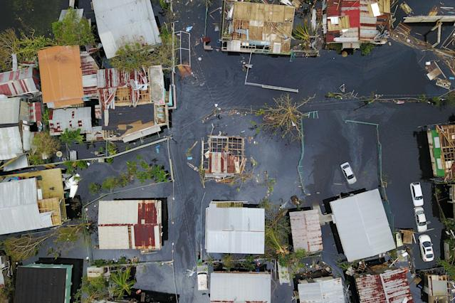 <p>An aerial view shows the flooded neighbourhood of Juana Matos in the aftermath of Hurricane Maria in Catano, Puerto Rico, on Sept. 22, 2017. (Photo: Ricardo Arduengo/AFP/Getty Images) </p>