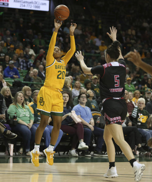 Baylor guard Juicy Landrum, left, scores past Arkansas State guard Payton Tennison, right, on a 3-point shot in the first half of an NCAA college basketball game, Wednesday, Dec. 18, 2019, in Waco, Texas. (Rod Aydelotte/Waco Tribune-Herald via AP)