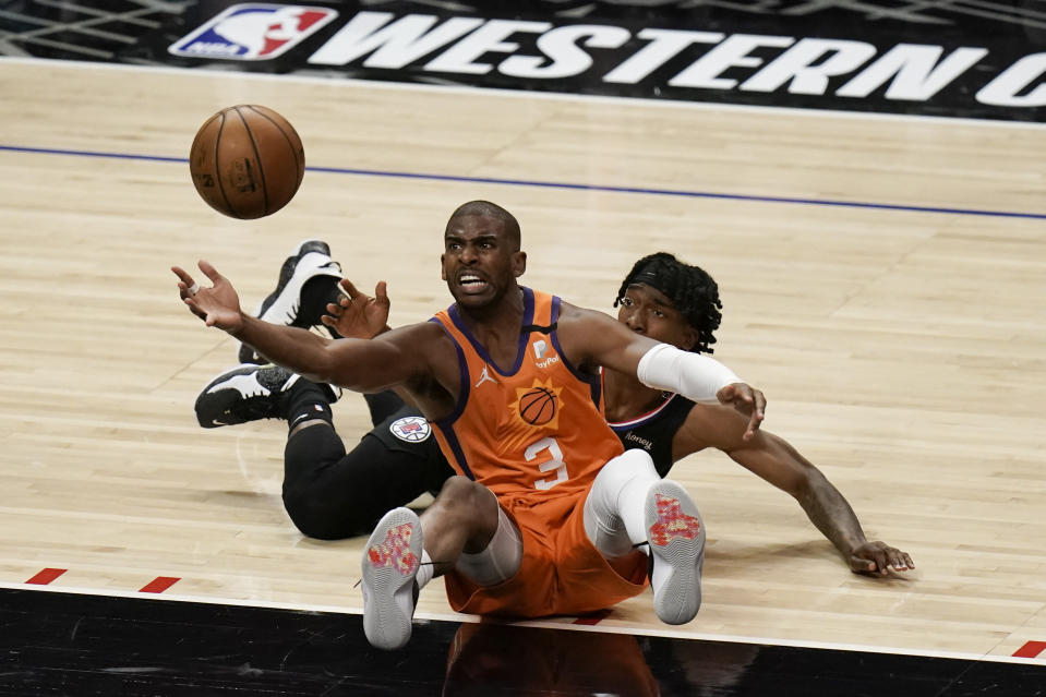 Phoenix Suns' Chris Paul retrieves the ball against Los Angeles Clippers' Terance Mann during the second half in Game 6 of the NBA basketball Western Conference Finals Wednesday, June 30, 2021, in Los Angeles. (AP Photo/Jae C. Hong)