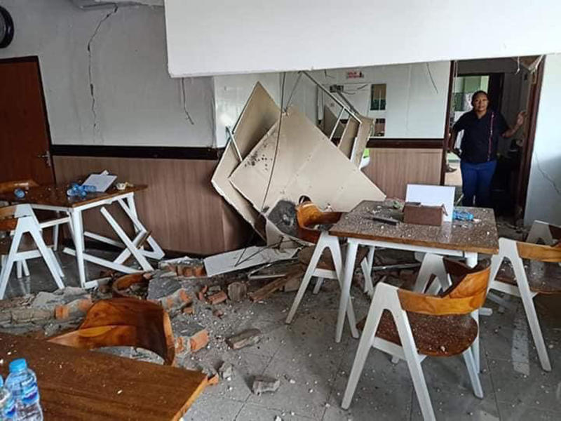A woman inspects the damage following an earthquake in Ambon, Maluku province, Indonesia, Thursday, Sept. 26, 2019. The strong earthquake Thursday killed a number of people and damaged a bridge, hospital and other buildings on one of Indonesia's less populated islands. (AP Photo)