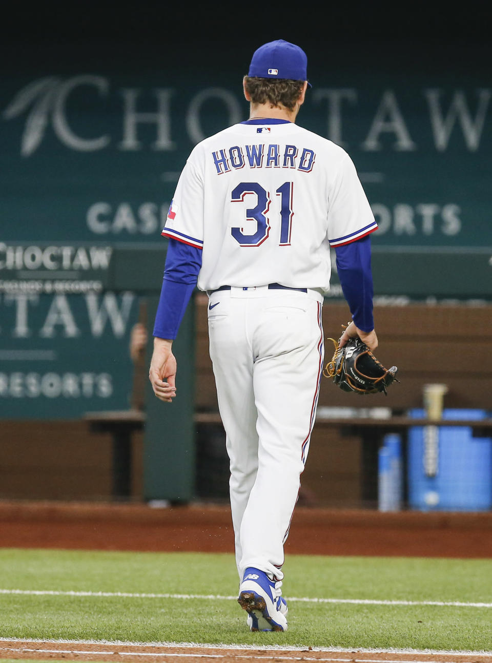 Texas Rangers starting pitcher Spencer Howard (31) is relieved in the third inning of a baseball game against the Los Angeles Angels, Thursday, Aug. 5, 2021, in Arlington, Texas. (AP Photo/Brandon Wade)