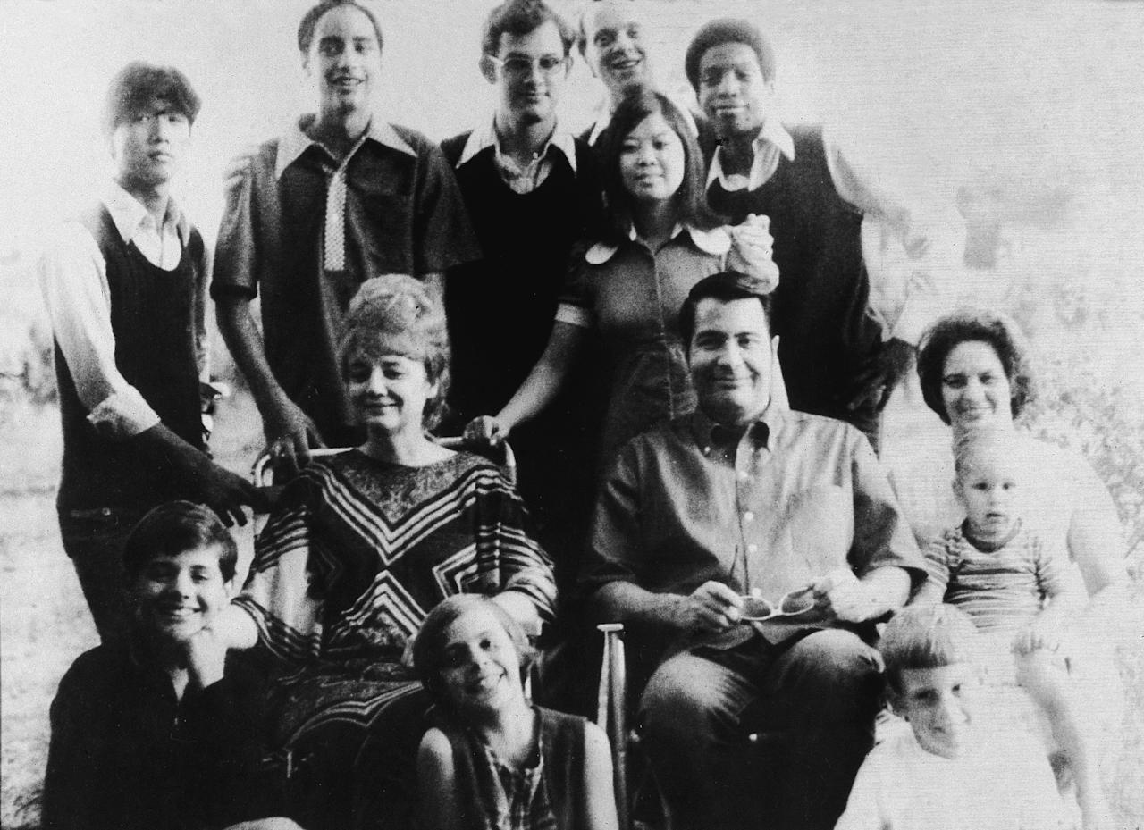 <p>Portrait of American religious leader Jim Jones (1931 – 1978), the founder of the People's Temple, and his wife, Marceline Jones (1927 – 1978), seated in front of their adopted children and next to his sister-in-law (right) with her three chilldren, California, 1976. In 1977, Jones relocated the People's Temple from San Francisco, California, to Jonestown, Guyana, where he led the mass suicide of over 900 members on Nov. 18, 1978, before dying of a gunshot wound later that day. (Photo: Don Hogan Charles/New York Times Co./Getty Images) </p>