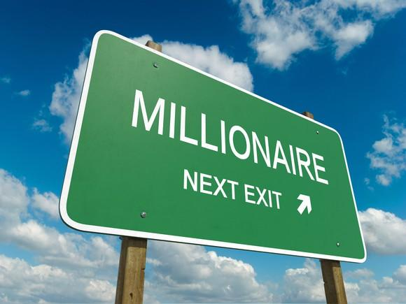 highway sign that points to millionaire as next exit