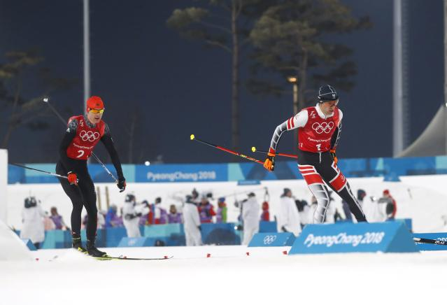 Nordic Combined Events - Pyeongchang 2018 Winter Olympics - Men's Team 4 x 5 km Final - Alpensia Cross-Country Skiing Centre - Pyeongchang, South Korea - February 22, 2018 - Wilhelm Denifl of Austria and Vinzenz Geiger of Germany compete. REUTERS/Kai Pfaffenbach