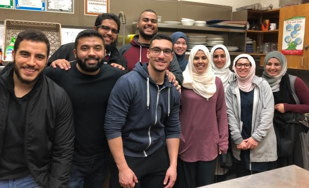 Volunteers from Halifax's Ummah Mosque serve hot breakfast to those in need