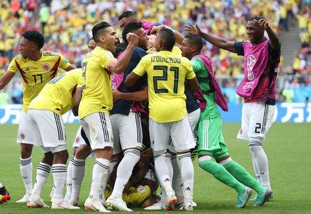 Soccer Football - World Cup - Group H - Colombia vs Japan - Mordovia Arena, Saransk, Russia - June 19, 2018 Colombia's Juan Fernando Quintero celebrates scoring their first goal with team mates REUTERS/Ricardo Moraes