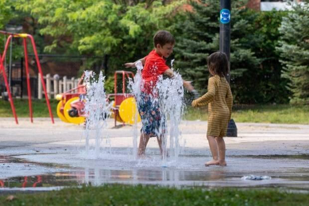 Kids in Ottawa flock to one of the city's splash pads to cool off during this August heat wave.  (Francis Ferland/CBC - image credit)