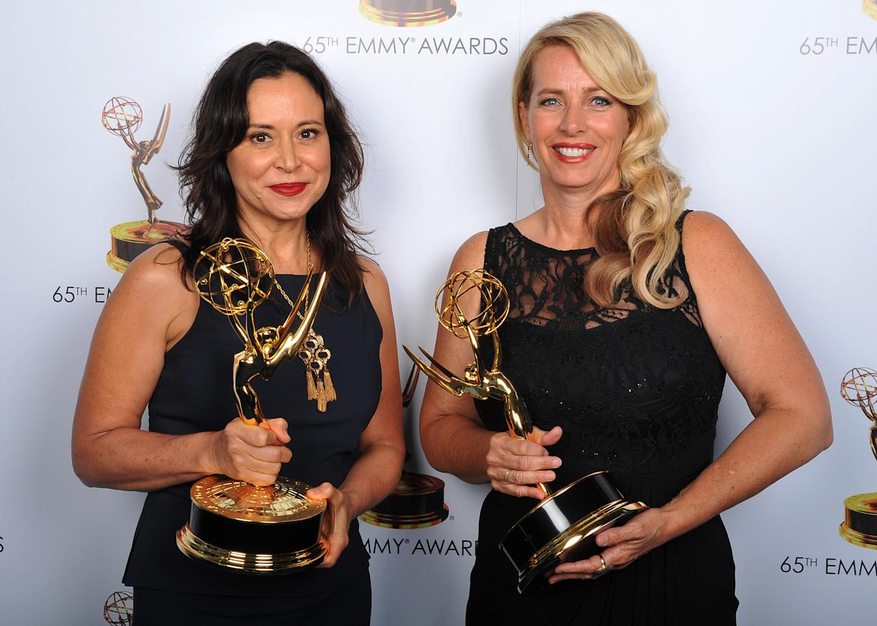 Marie Larkin and Yvette Stone pose for a portrait at the 2013 Primetime Creative Arts Emmy Awards, on Sunday, September 15, 2013 at Nokia Theatre L.A. Live, in Los Angeles, Calif. (Photo by Vince Bucci/Invision for Academy of Television Arts & Sciences/AP Images)
