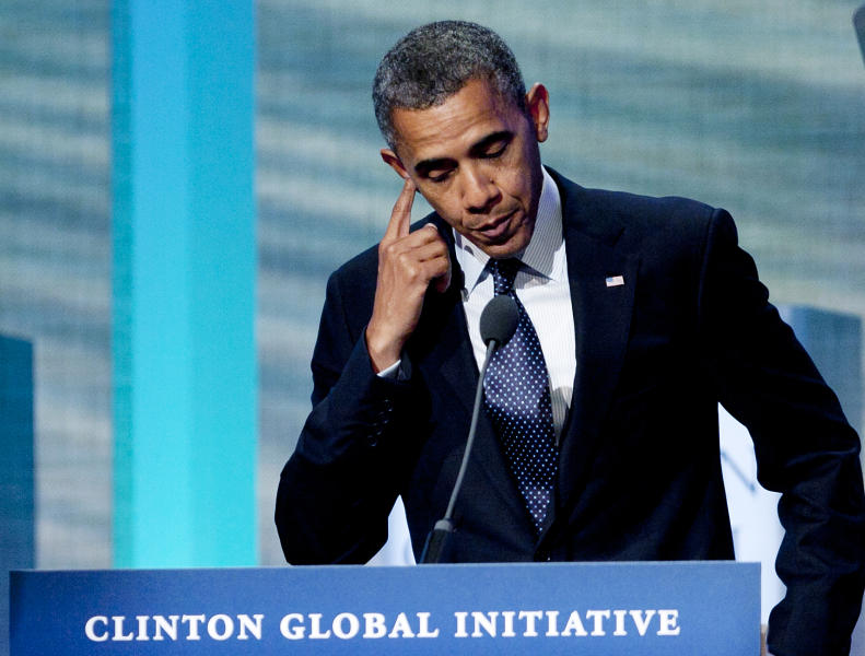 President Barack Obama pauses during his speech at the Clinton Global Initiative, Tuesday, Sept. 25, 2012, in New York. (AP Photo/Mark Lennihan)