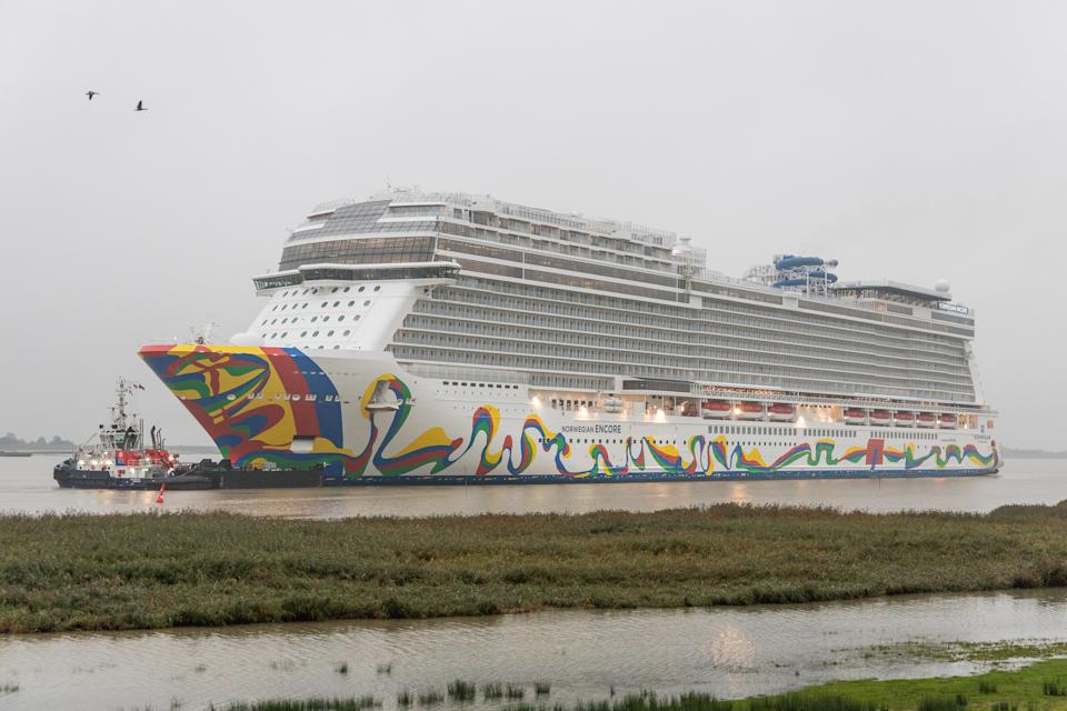 """01 October 2019, Lower Saxony, Terborg: The """"Norwegian Encore"""" as the newest cruise giant of the Meyer shipyard in Papenburg is being transported slowly backwards, pulled by tugs, on the Ems into the North Sea. The ship has room for 4,000 passengers. The ship is due to be handed over to Norwegian Cruise Lines in Bremerhaven at the end of October. Photo: Martin Remmers/dpa (Photo by Martin Remmers/picture alliance via Getty Images)"""