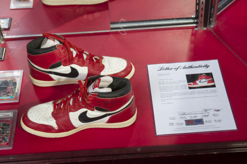 """A pair of Nike Air Jordan 1s, worn and signed by NBA basketball legend Michael Jordan in his rookie season, is pictured at the """"ShoeZeum"""" in downtown Las Vegas, Nevada September 25, 2012. Record keepers at the Guinness Book of World Records recently certified that Jordan Michael Geller's Shoezeum, a shrine to Nike that he says includes one of every model of Air Jordans ever made, holds the record for the world's largest collection of sneakers, with more than 2,500 pairs, all but eight of which are Nikes. Nike did not respond to calls for comment. Picture taken September 25, 2012. REUTERS/Steve Marcus (UNITED STATES - Tags: SOCIETY SPORT BASKETBALL)"""