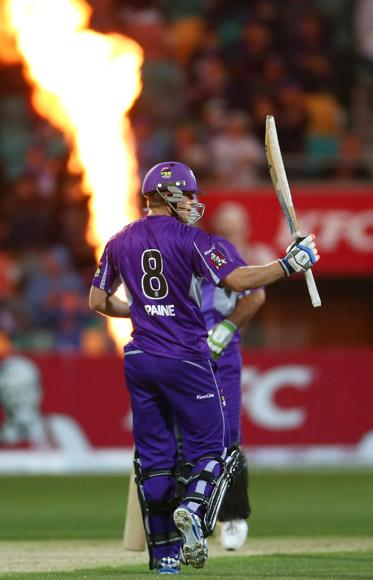Tim Paine of the Hurricanes raises his bat after scoring his half century during the Big Bash League match between the Hobart Hurricanes and the Perth Scorchers at Blundstone Arena on January 1, 2013 in Hobart, Australia.  (Photo by Robert Cianflone/Getty Images)