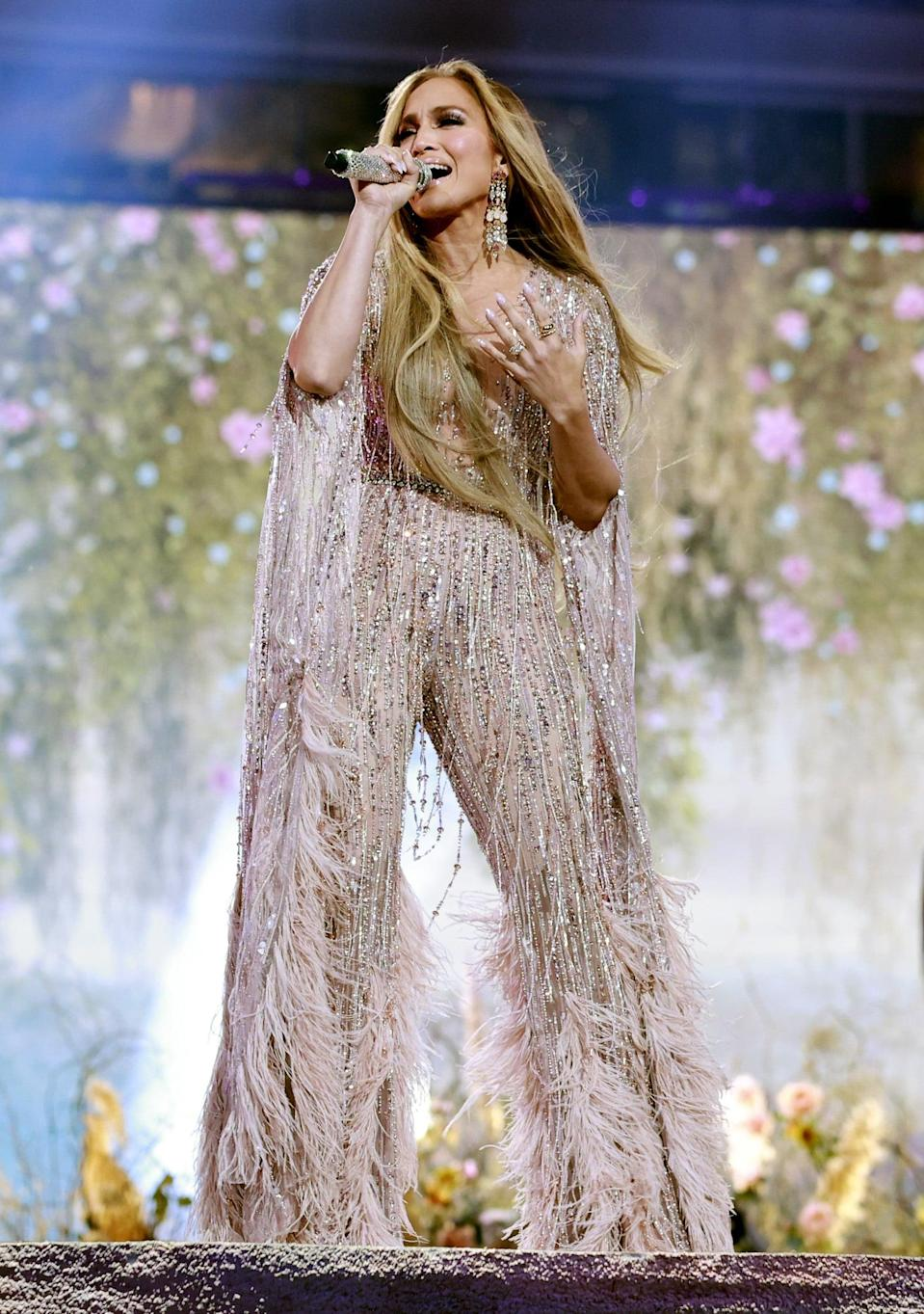 <p>This Couture look comes from Zuhair Murad's spring/summer 2021 collection, complete with feathered sleeves and flared pants, plus plenty of beaded tasseling. It was also complete with Vrai jewels for J Lo's performance.</p>