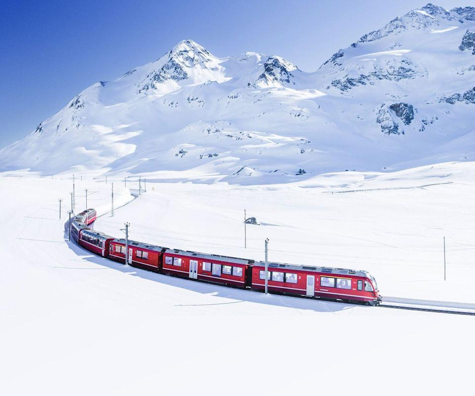 "<p>Another must-do Swiss rail holiday is the <a href=""https://www.goodhousekeeping.com/uk/lifestyle/travel/g28889864/glacier-express/"" rel=""nofollow noopener"" target=""_blank"" data-ylk=""slk:Glacier Express"" class=""link rapid-noclick-resp"">Glacier Express</a> in winter when you can take in the romantic Alpine scenery covered in snow. </p><p>Dubbed the world's slowest express train, it's an eight-hour experience that takes you through forests, over 291 bridges and through 91 tunnels, with the majestic peaks of the Alps all around.</p><p>The large windows allow you to take in all the views, with highlights including the arches of the Landwasser Viaduct and the jagged scenes of the Rhine Gorge.</p><p><strong>Take the Glacier Express from Chur to Brig during an unforgettable five-day winter lakes and rail holiday in Switzerland with Good Housekeeping from £1,125 per person.</strong> <a class=""link rapid-noclick-resp"" href=""https://www.goodhousekeepingholidays.com/tours/switzerland-swiss-alps-glacier-express-tour"" rel=""nofollow noopener"" target=""_blank"" data-ylk=""slk:FIND OUT MORE"">FIND OUT MORE</a></p>"