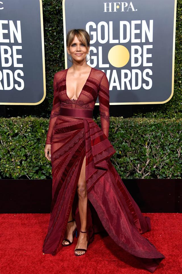 """<p>She looked like a total star in this <a href=""""https://www.popsugar.com/fashion/Halle-Berry-Dress-Golden-Globes-2019-45647347"""" class=""""ga-track"""" data-ga-category=""""Related"""" data-ga-label=""""https://www.popsugar.com/fashion/Halle-Berry-Dress-Golden-Globes-2019-45647347"""" data-ga-action=""""In-Line Links"""">sheer-paneled Zuhair Murad dress</a> at the Golden Globes in 2019.</p>"""