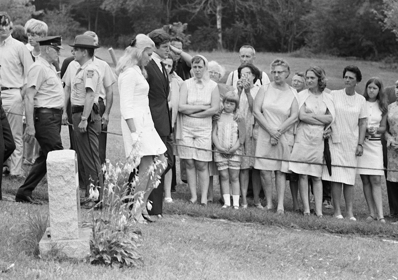 Sen. Edward M. Kennedy, and his wife, Joan, pass a tombstone as they attend the burial of Mary Jo Kopechne, a former aide of slain Sen. Robert F. Kennedy on July 22, 1969 in Plymouth, Pa. (Photo: AP)
