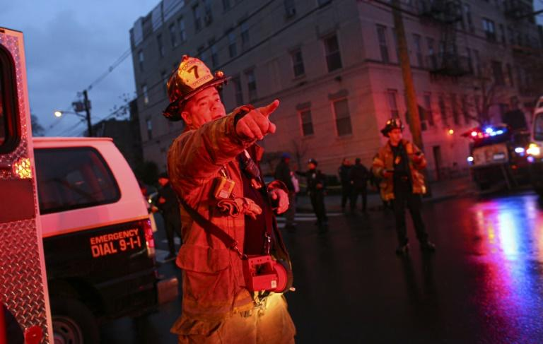 A firefighter responds to the emergency, which police said involved at least three locations