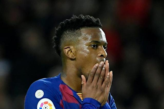 Barcelona's Portuguese defender Nelson Semedo did not train on Thursday following reports he attended a gathering of more than 20 people, against strict health guidelines (AFP Photo/LLUIS GENE)
