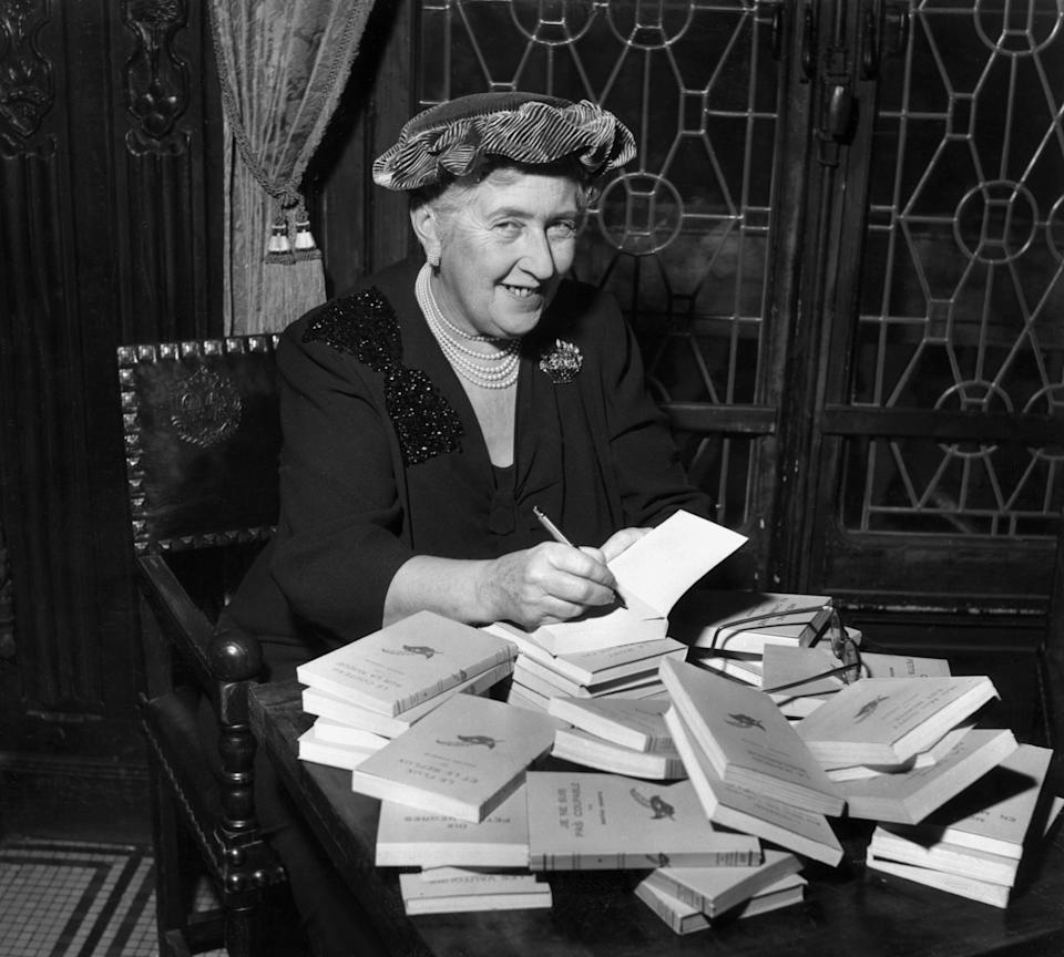 Agatha Christie (1890-1976) autographing French editions of her books, circa 1950.  (Photo by Hulton Archive/Getty Images)