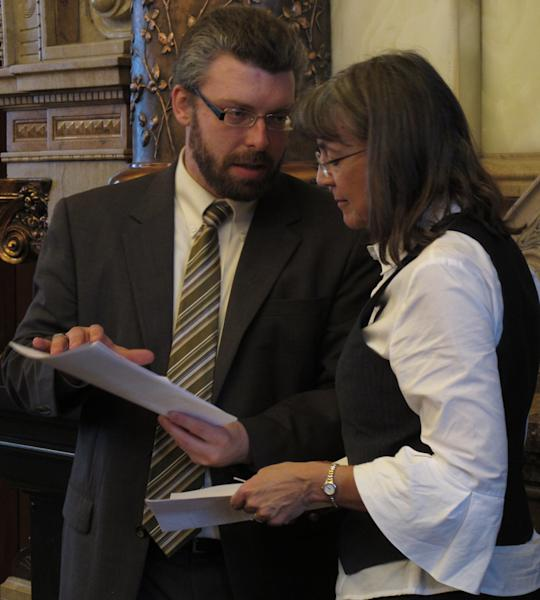 Landon Fulmer, left, policy director for Kansas Gov. Sam Brownback, consults with state Sen. Susan Wagle, right, a Wichita Republican, during a debate over tax cuts, Tuesday, March 20, 2012, at the Statehouse in Topeka, Kan. Wagle supports GOP Gov. Sam Brownback's plan to reduce income taxes as a way to stimulate economic growth. (AP Photo/John Hanna)