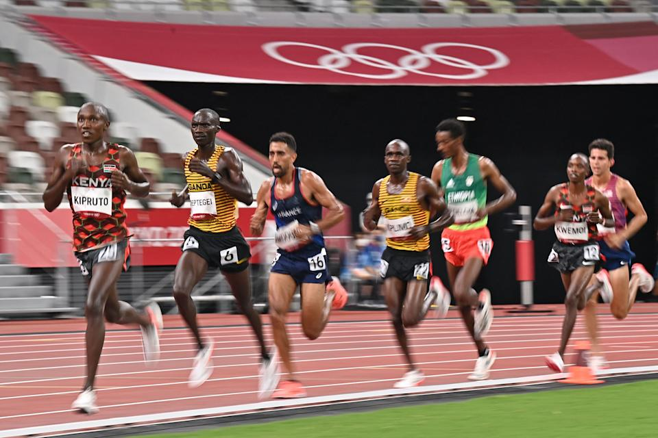 Kenya's Rhonex Kipruto (L), Uganda's Joshua Cheptegei (C) and France's Morhad Amdouni (R) compete in the men's 10000m final during the Tokyo 2020 Olympic Games at the Olympic Stadium in Tokyo on July 30, 2021. (Photo by Ben STANSALL / AFP) (Photo by BEN STANSALL/AFP via Getty Images)