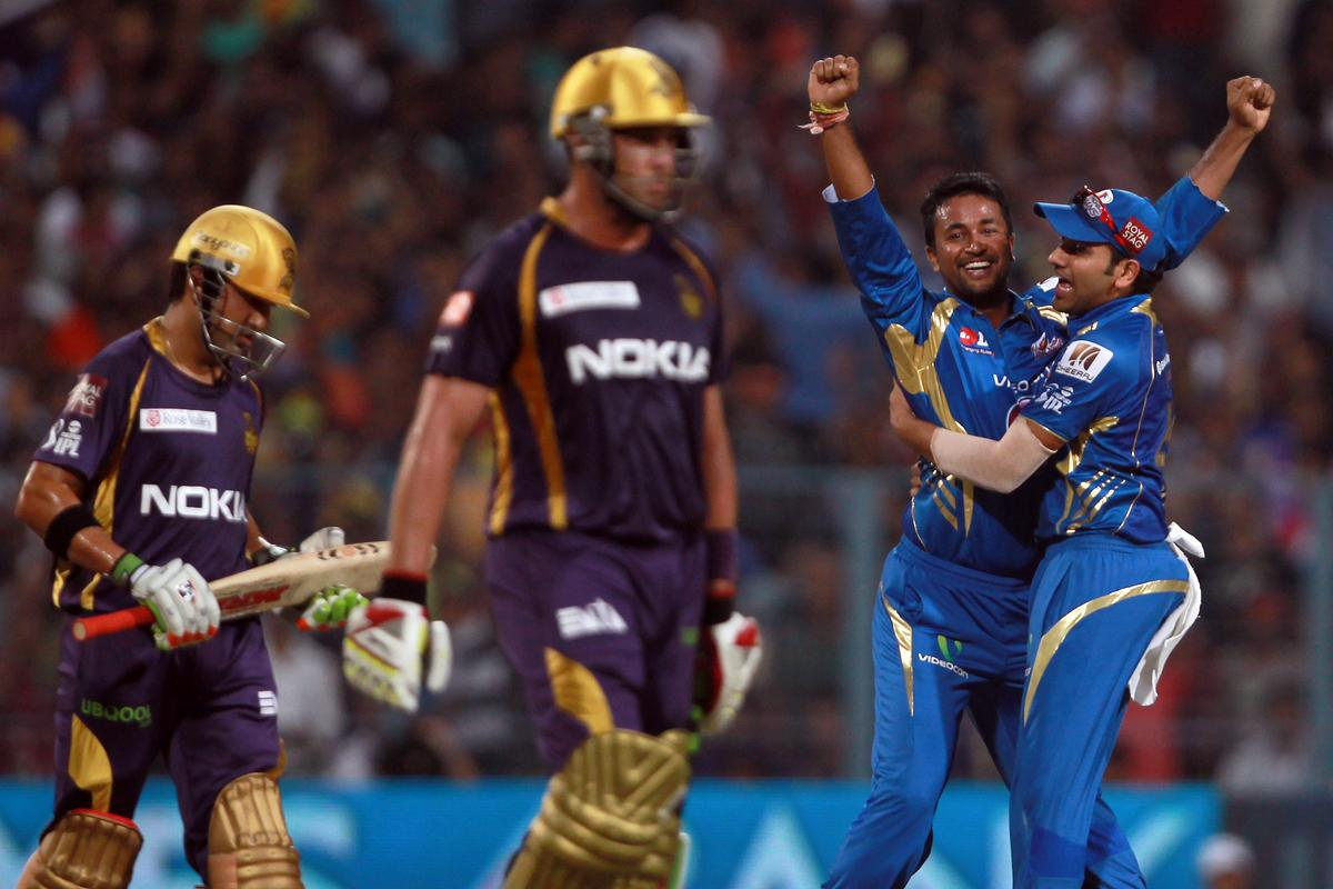 Pragyan Ohja celebrates the wicket of Gautam Gambhir with Rohit Sharma during match 33 of the Pepsi Indian Premier League between The Kolkata Knight Riders and The Mumbai Indians held at Eden Gardens Stadium, Kolkata on the 24th April 2013. Photo by Jacques Rossouw-IPL-SPORTZPICS   ..Use of this image is subject to the terms and conditions as outlined by the BCCI. These terms can be found by following this link:..https://ec.yimg.com/ec?url=http%3a%2f%2fwww.sportzpics.co.za%2fimage%2fI0000SoRagM2cIEc&t=1506398580&sig=L21SdmKXSJbnbCHgK6dV5g--~D