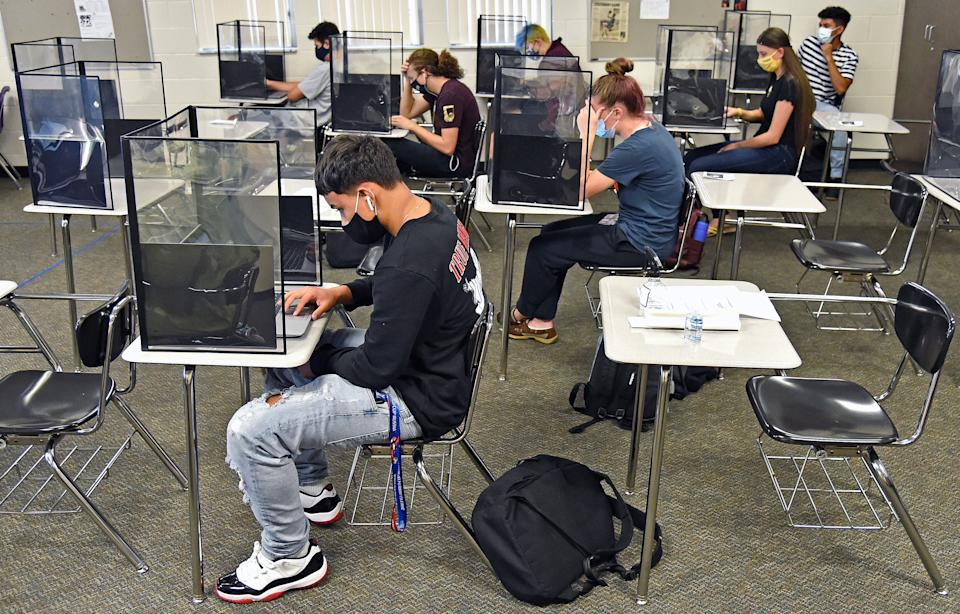 Booker High School students work in a classroom set up for social distancing.
