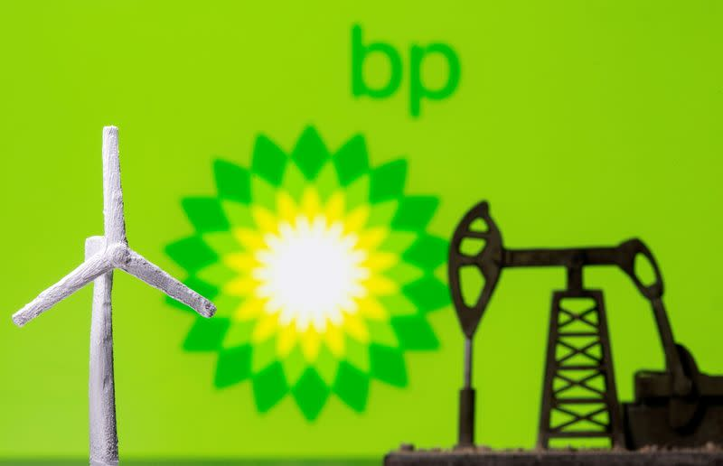 FILE PHOTO: A 3D printed windmill and oil pump jack are seen in front of displayed BP (British Petroleum) logo in this illustration picture
