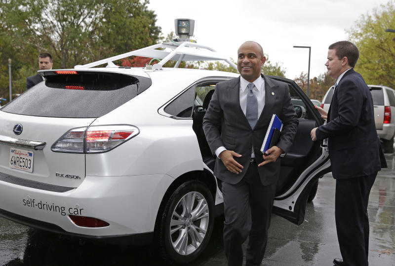 Haiti's Prime Minister Laurent Lamothe, center, gets out of the Google self-driving car during a tour at the Google headquarters complex Wednesday, Nov. 20, 2013, in Mountain View, Calif. From Google to Facebook to Apple, Lamothe plans to spend Wednesday on a whirlwind tour through Silicon Valley's most elite tech campuses, hoping to convince some of the world's wealthiest and most successful corporate executives to share support and innovation with the poorest country in the Americas. (AP Photo/Eric Risberg)