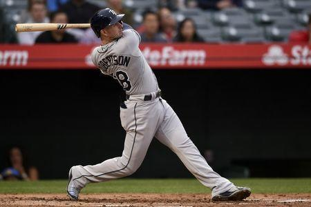 May 19, 2018; Anaheim, CA, USA; Tampa Bay Rays shortstop Daniel Robertson (28) follows through on a swing for a grand slam during the second inning against the Los Angeles Angels at Angel Stadium of Anaheim. Mandatory Credit: Kelvin Kuo-USA TODAY Sports