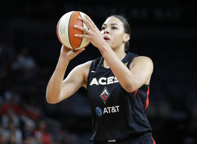 FILE - In this Sept. 24, 2019, file photo, Las Vegas Aces' Liz Cambage (8) plays against the Washington Mystics during the first half of Game 4 of a WNBA playoff basketball series in Las Vegas. Cambage started a GoFundMe page to raise money to help after fires that have devastated her native Australia. The money raised will be divided and distributed equally between many groups, including the Australian Red Cross Disaster Recovery and Relief and World Wildlife Foundation Australia. (AP Photo/John Locher, File)