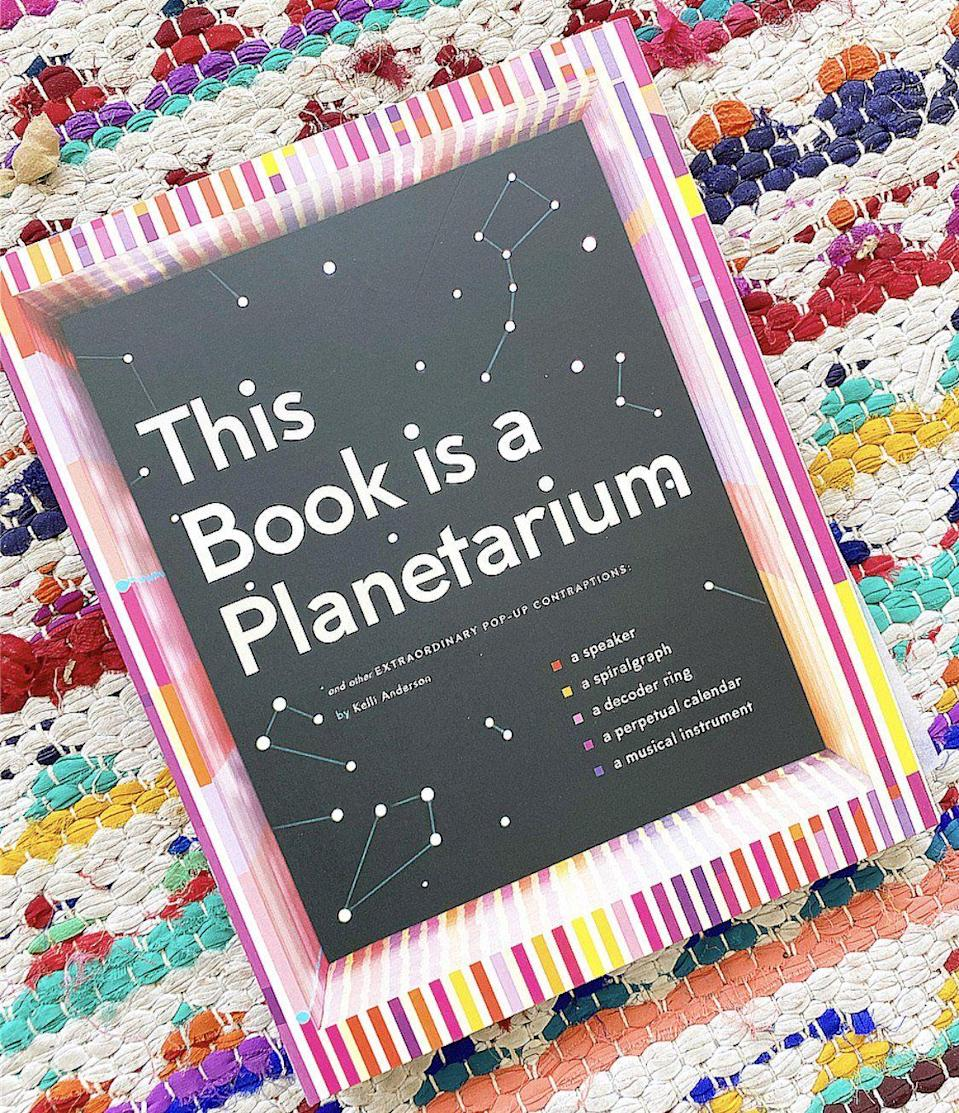"<p><strong>Chronicle Books</strong></p><p>braveandkindbooks.com</p><p><strong>$40.00</strong></p><p><a href=""https://www.braveandkindbooks.com/products/this-book-is-a-planetarium-and-other-extraordinary-pop-up-contraptions-popup-book-for-kids-and-adults-interactive-planetarium-book-cool-books-for-adults"" rel=""nofollow noopener"" target=""_blank"" data-ylk=""slk:Shop Now"" class=""link rapid-noclick-resp"">Shop Now</a></p><p>This is a pop-up book that kids and adults can enjoy together. Each page transforms into different amazing things, all made of paper, including a working speaker, a planetarium, a spirograph and an instrument. <em>Ages 8+</em></p>"