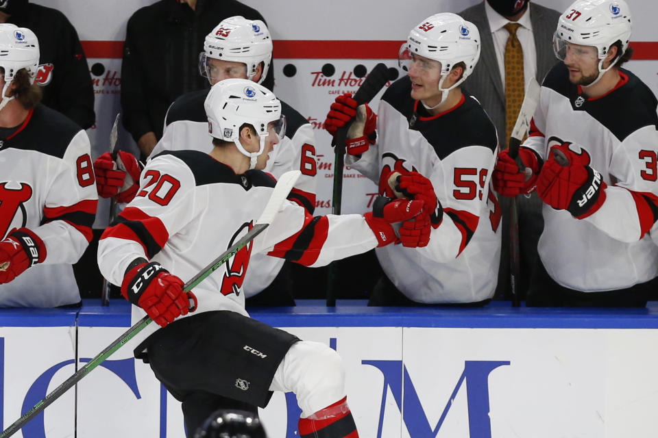 New Jersey Devils forward Michael McLeod (20) celebrates his second goal of the game during the third period of an NHL hockey game against the Buffalo Sabres, Sunday, Jan. 31, 2021, in Buffalo, N.Y. (AP Photo/Jeffrey T. Barnes)
