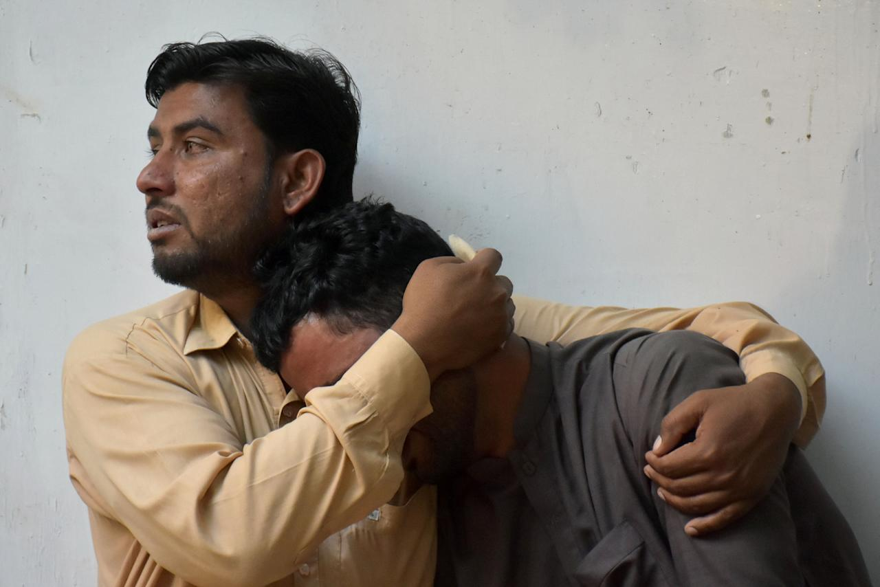 Relatives mourn the death of two police officers, who were killed by unidentified gunmen, at the hospital morgue in Quetta, Pakistan May 27, 2018. REUTERS/Naseer Ahmed
