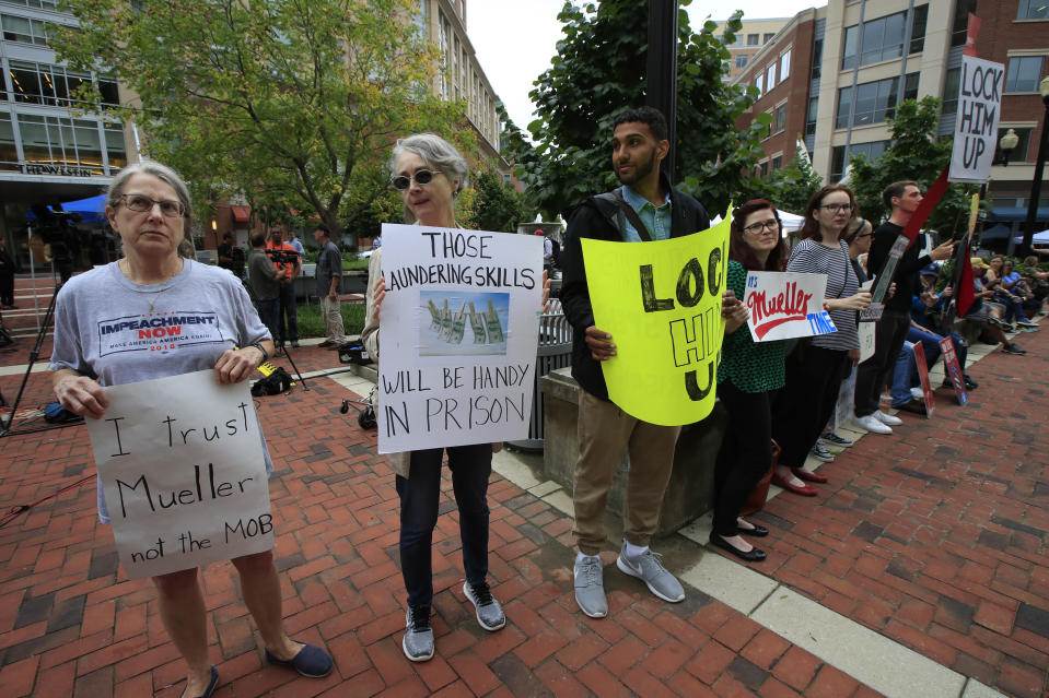 <p>Linda Schierow, from left, and Nancy Bundy, join other protesters outside the Alexandria Federal Courthouse in Alexandria, Va., Tuesday, July 31, 2018, on day one of Paul Manafort's trial. (Photo: Manuel Balce Ceneta/AP) </p>