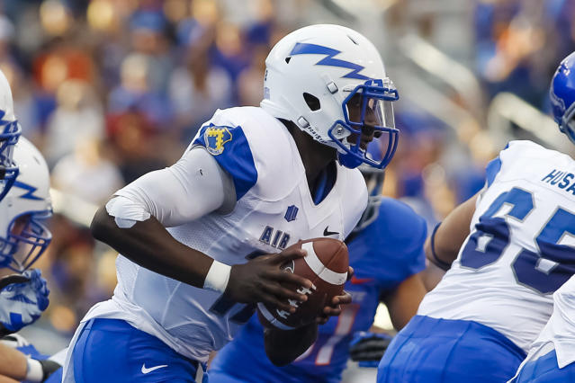 Air Force quarterback Jaleel Awini (12) moves with the ball during the first half of an NCAA college football game against Boise State in Boise, Idaho, Friday, Sept. 13, 2013. (AP Photo/Otto Kitsinger)