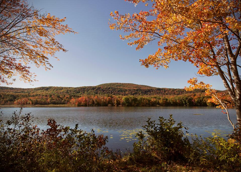 """Though the <a href=""""https://www.cntraveler.com/story/what-to-do-in-the-berkshires?mbid=synd_yahoo_rss"""" rel=""""nofollow noopener"""" target=""""_blank"""" data-ylk=""""slk:Berkshires"""" class=""""link rapid-noclick-resp"""">Berkshires</a>, in western Massachusetts, are a year-round destination with skiing, mountain trails, and swimming holes, autumn will always be their season. That's when the region's mighty oaks turn a spectrum of golds, reds, and oranges, though the chill in the fresh New England air may force you off that Adirondack hike and indoors a little earlier than planned. But don't fight it. Throw on a couple of layers, and aim for the area's highest peak, Mount Greylock, where you'll peep into five states from the summit on a clear day; stop into the old wooden bar at the historic <a href=""""https://www.cntraveler.com/hotels/united-states/stockbridge/the-red-lion-inn?mbid=synd_yahoo_rss"""" rel=""""nofollow noopener"""" target=""""_blank"""" data-ylk=""""slk:Red Lion Inn"""" class=""""link rapid-noclick-resp"""">Red Lion Inn</a> for apple pie and a Sam Adams afterwards. Should rain set in, while away an afternoon at the country's largest contemporary art museum, Mass MoCA. Or, head to new guesthouses like the regal Granville House, with its cozy parlors where you'll want to sink into the plump sofas with tea or cocktail and sip away the afternoon, looking out windows framing gorgeous foliage views. All that said, the most attractive reason to go now is the two-month old <a href=""""https://www.cntraveler.com/story/miraval-berkshires-resort-and-spa-first-in?mbid=synd_yahoo_rss"""" rel=""""nofollow noopener"""" target=""""_blank"""" data-ylk=""""slk:Miraval"""" class=""""link rapid-noclick-resp"""">Miraval</a>, where you'll—crucially—reset the mind with horse riding, rope courses, and a massage from a veteran local therapist who can help suspend the stress of the year, even if just for a short while. <em>—Erin Florio</em>"""