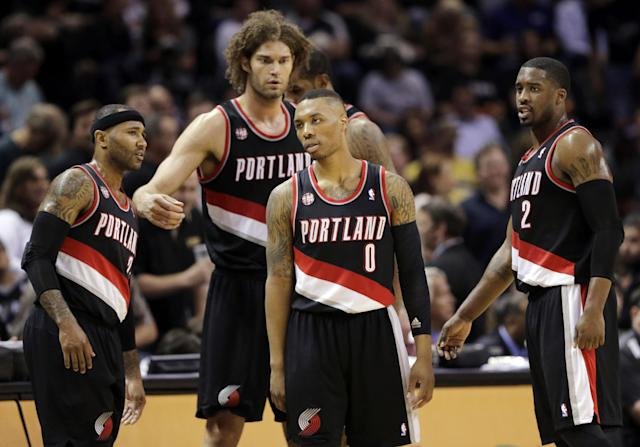 Portland Trail Blazers' Damian Lillard (0) and teammates wait to enter the game following a timeout during the first half of Game 1 of a Western Conference semifinal NBA basketball playoff series against the San Antonio Spurs, Tuesday, May 6, 2014, in San Antonio. (AP Photo/Eric Gay)