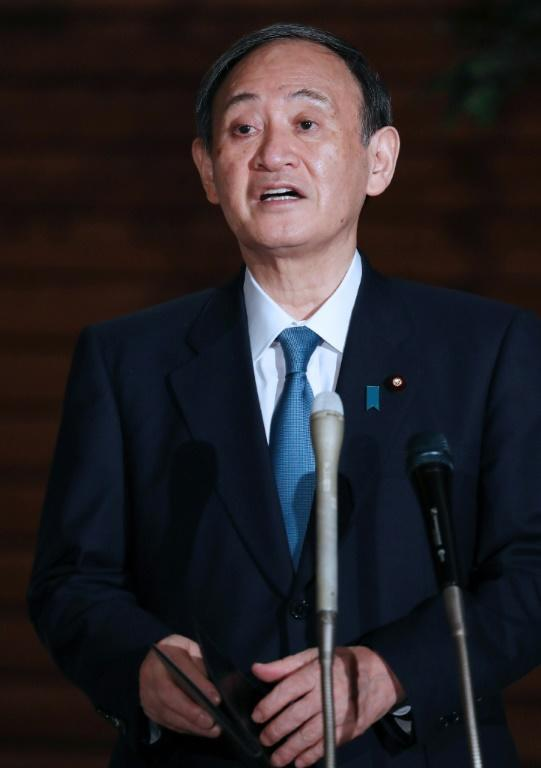 Japan's Prime Minister Yoshihide Suga speaks to the media following the earthquake, which he said produced no major casualties