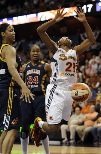 Connecticut Sun's Renee Montgomery, right, has the ball knocked away from her by Indiana Fever's Tammy Sutton-Brown during the first half of Game 1 of the WNBA basketball Eastern Conference Finals in Uncasville, Conn., Friday, Oct. 5, 2012. (AP Photo/Jessica Hill)